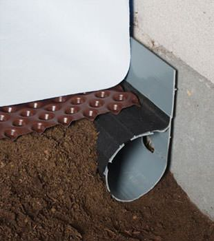 Closeup of a crawl space drainage system installed in Avon