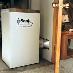 A basement dehumidifier with an ENERGY STAR® rating ducting dry air into a finished area of the basement  in Willoughby