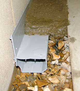 A basement drain system installed in a Lakewood home