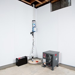 Sump pump system, dehumidifier, and basement wall panels installed during a sump pump installation in Brunswick