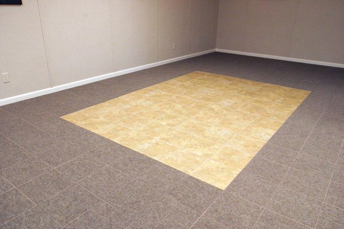 tiled and carpeted basement flooring installed in a Youngstown home